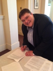 Signing the pastoral contract after the congregational vote.